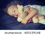 baby sleeping with toy | Shutterstock . vector #405159148