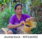 thai lady makes wicker work... | Shutterstock . vector #405166402