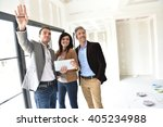couple with realtor visiting... | Shutterstock . vector #405234988