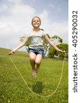 little girl skipping with... | Shutterstock . vector #405290032
