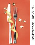 knife, fork with ribbon, stars \ crhistmas holiday red background - stock photo