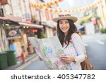 happy travel woman look map and ... | Shutterstock . vector #405347782