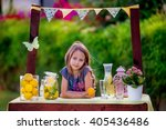 Small photo of Girl stand at the lemonade stand