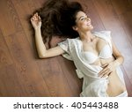 woman in lingerie laying on the ... | Shutterstock . vector #405443488