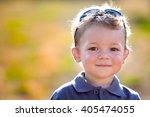 happy smiling child outdoor in... | Shutterstock . vector #405474055