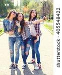 young happy teenage girls... | Shutterstock . vector #405548422