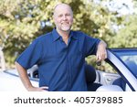 a senior man standing by his car | Shutterstock . vector #405739885