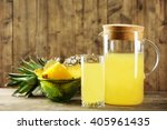 pineapple slices and juice in... | Shutterstock . vector #405961435