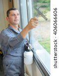 Man Cleaning Window With...