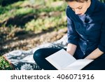 girl reading a book in nature ... | Shutterstock . vector #406071916