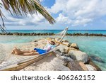 man relaxing in a hammock at... | Shutterstock . vector #406262152