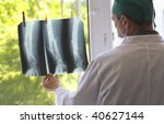 doctor watching x ray pictures   Shutterstock . vector #40627144