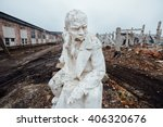 Damaged Lenin Statue Sitting O...