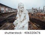 Damaged Lenin Statue Sitting O...