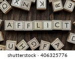 Small photo of the word of AFFLICT on building blocks concept