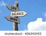 "Small photo of ""Life, balance, work"" - wooden signpost, cloudy sky"