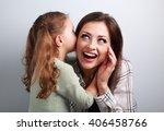 happy kid girl whispering the...   Shutterstock . vector #406458766