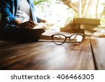 close up of eye glasses on wood ... | Shutterstock . vector #406466305