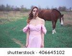 Girl In A Dress Near A Horse