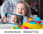 baby boy taking selfie with a... | Shutterstock . vector #406667152