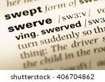 Small photo of Close up of old English dictionary page with word swerve