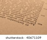 Small photo of sepia toned old open book page with ancient latin text of Aeneid by Virgil