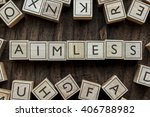 Small photo of the word of AIMLESS on building blocks concept
