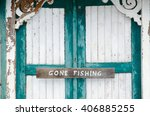Closeup Of A Gone Fishing Sign...