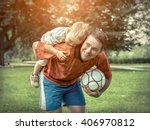 father and son playing football ... | Shutterstock . vector #406970812