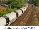 freight train passing by with... | Shutterstock . vector #406973332