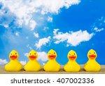Rubber Ducks On Beach