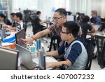 asian colleagues software... | Shutterstock . vector #407007232
