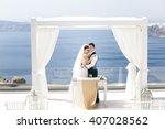 beautiful newlyweds hugging on... | Shutterstock . vector #407028562