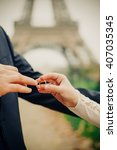 bride puts wedding ring on a... | Shutterstock . vector #407035345