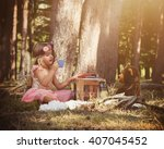 a little girl is sitting in the ... | Shutterstock . vector #407045452