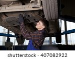 car mechanic working in auto