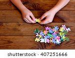 Child Working On Jigsaw Puzzle...