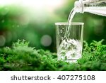 the glass of cool fresh water... | Shutterstock . vector #407275108