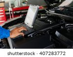 mechanic using diagnostic... | Shutterstock . vector #407283772