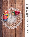 nesting dolls and lace on the... | Shutterstock . vector #407295712
