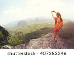 young woman hiker use... | Shutterstock . vector #407383246