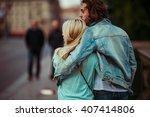 romantic young couple walking   ... | Shutterstock . vector #407414806