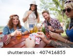 close up of cards in hands of... | Shutterstock . vector #407416855