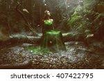 woman wears a green dress in... | Shutterstock . vector #407422795