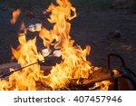 marshmallows roasting over the...   Shutterstock . vector #407457946