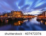 Stock photo amsterdam canal during twilight time 407472376