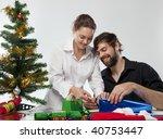 couple preparing christmas... | Shutterstock . vector #40753447