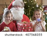 a grandfather dressed as santa... | Shutterstock . vector #407568355