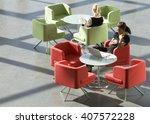 two businesswomen sitting at... | Shutterstock . vector #407572228
