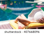 woman  relaxing on a chaise... | Shutterstock . vector #407668096